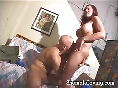 Domineer redhead shemale gets a conscientious blowjob forwards she fucks