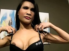Longing haired ladyboy strokes their..